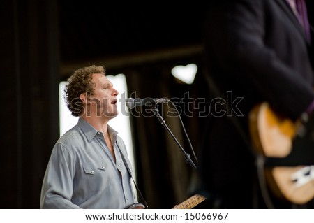 Sacramento, CA - July 17,2008: Bassist Davey Faragher performs onstage at the Sleep Train Amphitheater in Marysville, CA with Elvis Costello and the Imposters - stock photo