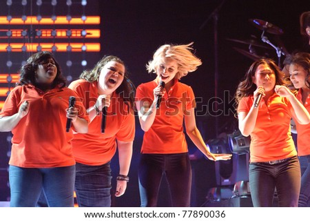SACRAMENTO, CA - MAY 23: Amber Riley, Ashley Fink, Dianna Agron and Jenna Ushkowitz   perform at the Glee Live! In Concert! tour at the Power Balance Pavilion on May 23, 2011 Sacramento, California. - stock photo