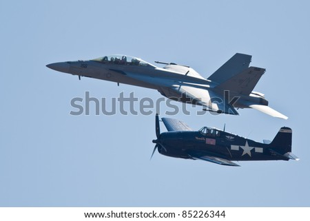 SACRAMENTO, CA - SEPT 10: Grumman F6F Hellcat WW II aircraft and Boeing F/A-18 Super Hornet aircraft during heritage flight at the California Capital Airshow, on September 10, 2011 in Sacramento, CA. - stock photo