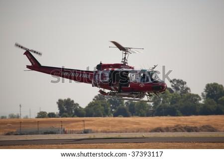 SACRAMENTO, CA - SEPT 13: UH-1 Huey Metro Fire helicopter at California Capital Airshow, September 13, 2009, Mather Airport, Sacramento, CA - stock photo