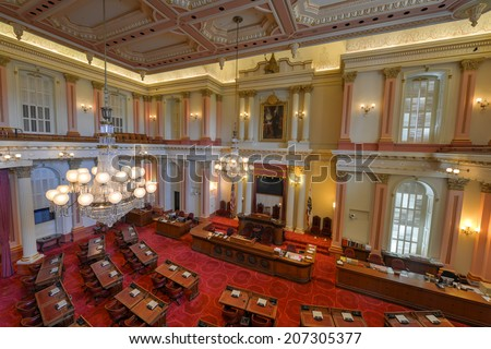 SACRAMENTO, CALIFORNIA - MAY 31, 2014: An empty Senate Chamber in the California State Capitol building on May 31, 2014 in Sacramento, California - stock photo