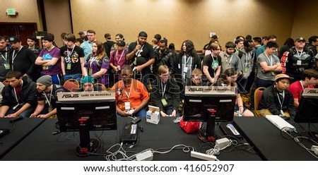 SACRAMENTO - MARCH 26: Unidentified gamers await their turn at Super Smash Bros. video game competition on March 26, 2016 at NCR NorCal Regionals, the premier fighting game tournament. - stock photo