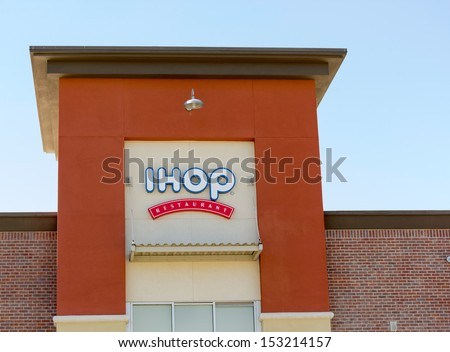 SACRAMENTO, USA - SEPTEMBER 5, 2013: IHOP restaurant sign. IHOP (International House of Pancakes) is a United States ??based restaurant chain that specializes in breakfast foods.  - stock photo