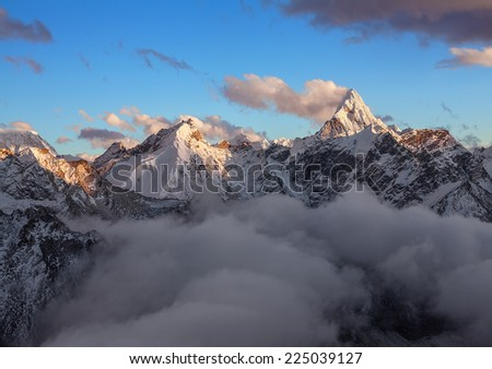 Sacred Ama Dablam peak (6814 m) at sunrise. Nepal, Himalayas. Canon5D MkII. - stock photo