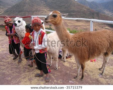 SACRED VALLEY, PERU - JULY 25: Peruvian Children in traditional garments July 25, 2006 in the Sacred Valley, near Machu Picchu, Peru. - stock photo
