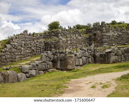 Sacsayhuaman. a walled complex and ancient inca fortress on the northern outskirts of the city of Cusco, Peru, the former capital of the Inca Empire. - stock photo