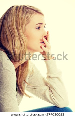 Sad and depressed woman deep in thought. - stock photo