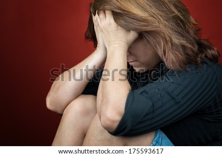 Sad and desperate woman crying (with space for text) - stock photo