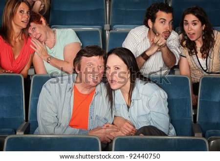 Sad and disgusted groups of people in a theater - stock photo