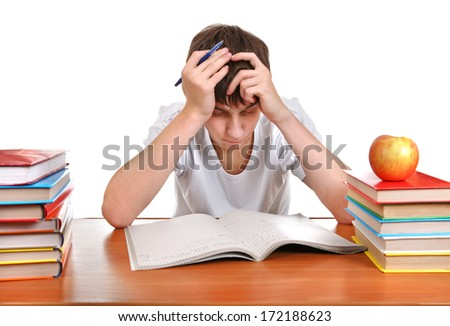 Sad and Tired Student at the Desk with many Books on the White Background - stock photo
