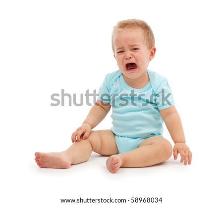 Sad baby boy sitting and crying - stock photo
