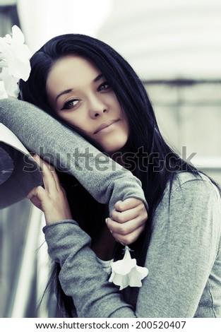 Sad beautiful fashion woman daydreaming - stock photo