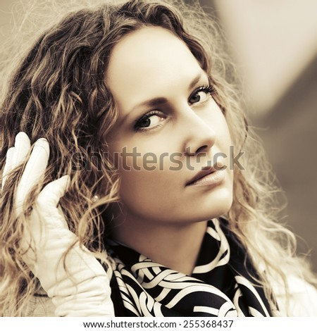 Sad beautiful fashion woman with long curly hairs  - stock photo