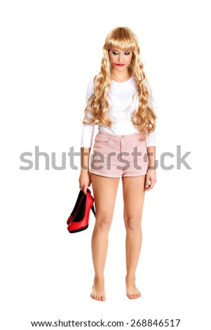 Sad blonde woman with smeared red lipstick. - stock photo