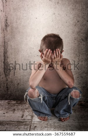 Sad boy alone - stock photo