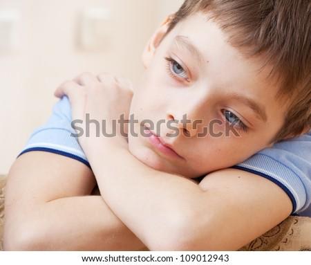 Sad boy. Depression child at home - stock photo