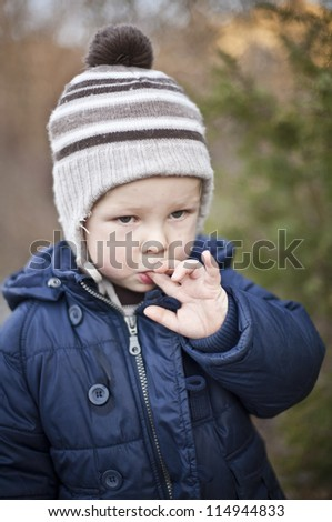 sad boy portrait expresion in autumn on the walk in forest - stock photo