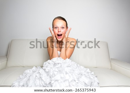 Sad bride crying, smitten, feeling low and depressed - stock photo