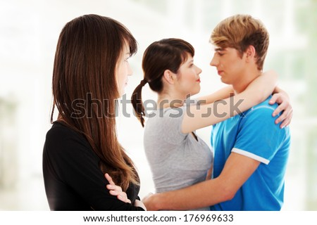 Sad brunette girl jealousy about her friends - stock photo