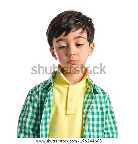 Sad brunette kid over isolated white background  - stock photo