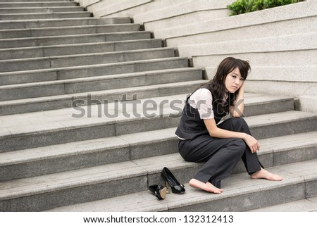 Sad business woman feel worried and stressed in outside of modern city. - stock photo