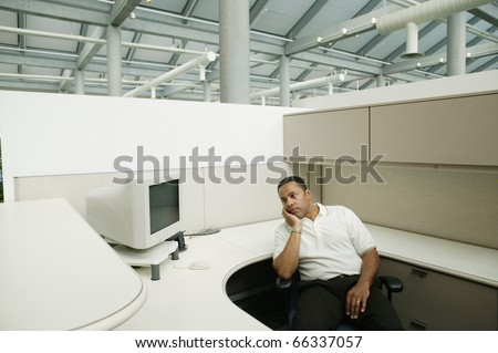 Sad businessman in empty office - stock photo