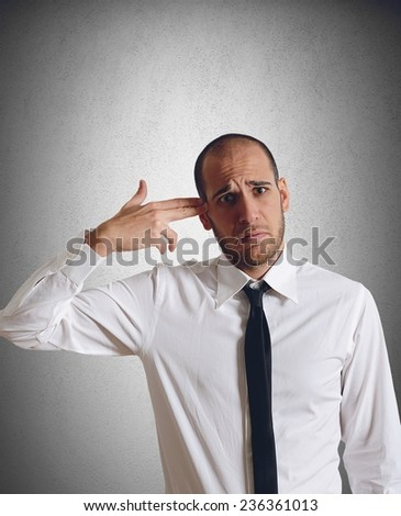 Sad businessman shoots himself for the crisis - stock photo