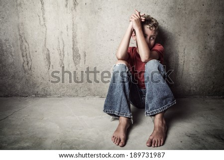 Sad child alone - stock photo