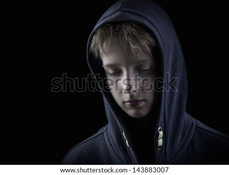 sad child on black - stock photo
