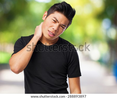sad chinese-man backache - stock photo
