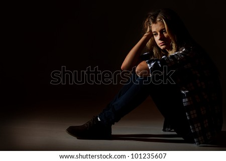 Sad college student - stock photo