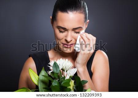 sad crying woman at funeral - stock photo