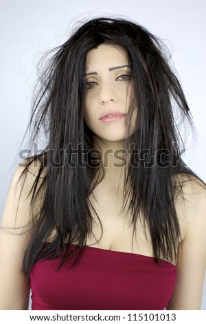 Sad depressed beautiful woman about her messy hair - stock photo