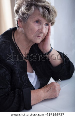 Sad elderly woman feeling lonely and miserable - stock photo