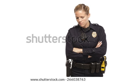Sad female police officer with arms crossed - stock photo
