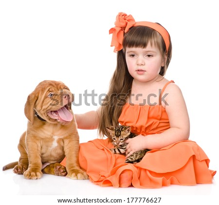 sad girl and her pets - a dog and a kitten. isolated on white background - stock photo