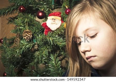 Sad girl at christmas - stock photo
