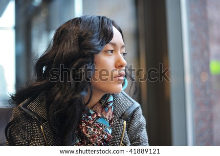 Sad girl in cafe - stock photo