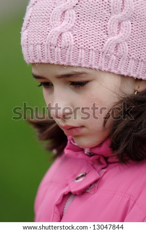 Sad girl in pink cap look depressed - stock photo