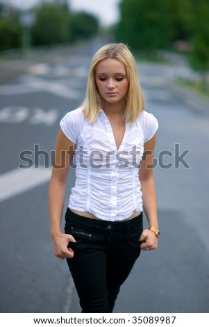 sad girl in the middle of the street - stock photo