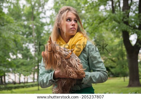 sad girl in the with dog looking right - stock photo