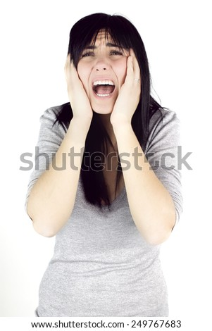 Sad girl suffering strong pain - stock photo