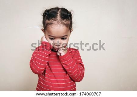 Sad girl with a bandaged finger - stock photo