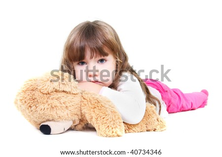 sad girl with teddy bear over white - stock photo