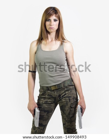 Sad girl with two guns on white background - stock photo