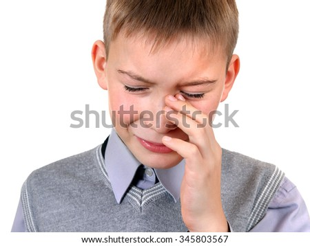 Sad Kid Weeps on the White Background closeup - stock photo