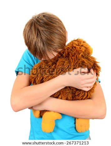 Sad Kid with Plush Toy on the White Background - stock photo