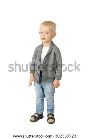 Sad little boy standing isolated on white background - stock photo
