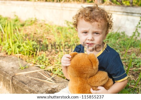 sad little boy with toy - stock photo