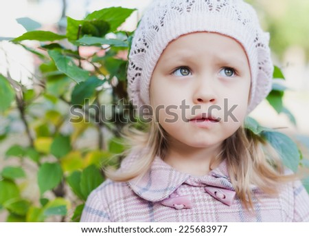 Sad little girl - stock photo